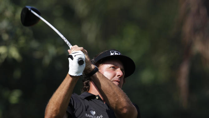 Phil Mickelson of the U.S. tees off at the 12th hole during the first round of the WGC-HSBC Champions golf tournament in Dongguan, southern China's Guangdong province, Thursday Nov. 1, 2012. (AP Photo/Kin Cheung)