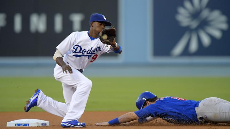 Chicago Cubs' Chris Coghlan, right, steals second as Los Angeles Dodgers second baseman Dee Gordon takes a late throw from home during the first inning of a baseball game, Friday, Aug. 1, 2014, in Los Angeles. (AP Photo/Mark J. Terrill)