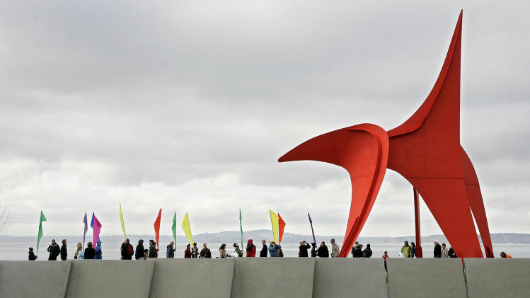 "FILE - This Jan. 20, 2007 file photo shows the ""Eagle"" sculpture by Alexander Calder, during the grand opening and dedication of the Olympic Sculpture Park in Seattle.  The Seattle Art Museum opened the art park on the downtown waterfront in 2007 to bring a free cultural experience to visitors.  (AP Photo/Dustin Snipes, file)"