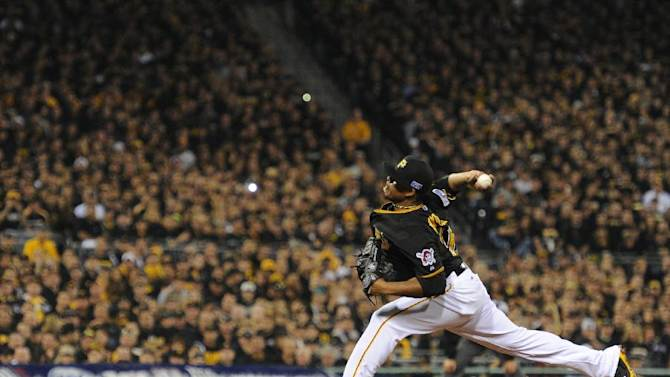 Pittsburgh Pirates starting pitcher Edinson Volquez throws against the San Francisco Giants in the first inning of the wild-card playoff baseball game on Wednesday, Oct. 1, 2014, in Pittsburgh. (AP Photo/Don Wright)