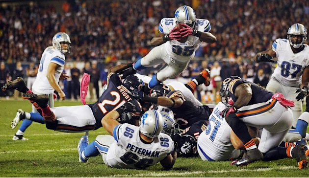 Detroit Lions running back Joique Bell (35) leaps toward the end zone in the second half of an NFL football game against the Chicago Bears in Chicago, Monday, Oct. 22, 2012. Bell fumbled on the play a