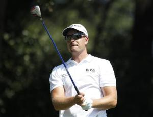 Henrik Stenson watches his shot from the third tee during the first round of the Tour Championship golf tournament in Atlanta
