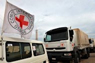 International Red Cross vehicles are shown in Sirte in 2011. Armed assailants laid siege on Sunday to a residence of Red Cross staff in the western Libyan city of Misrata, causing major damage to the building, the organisation said