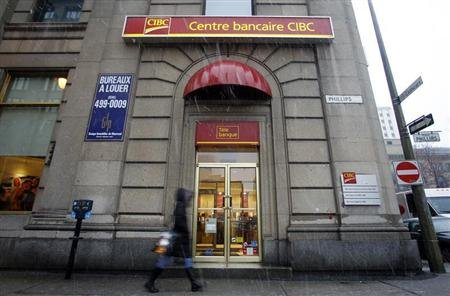 A pedestrian walks past a CIBC branch in Montreal