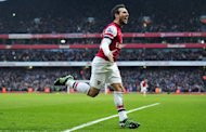 Arsenal midfielder Santi Cazorla celebrates scoring against Aston Villa on February 23, 2013. Arsenal put their recent woes behind them as Cazorla completed a brace with an 85th-minute goal that condemned relegation-threatened Aston Villa to a 2-1 defeat at the Emirates