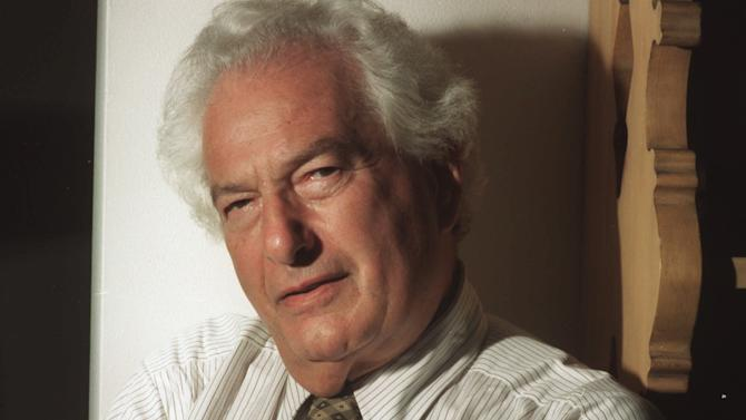 """FILE - This Sept. 27, 1994 file photo shows Joseph Heller, author of the classic anti-war novel """"Catch 22,"""" in New York. Heller's old wooden desk and type on the battered typewriter he used to compose """"Catch-22"""" are on display in an exhibit at the University of South Carolina's Columbia campus library. (AP Photo/Jim Cooper, File)"""