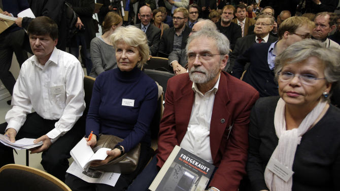 Former DDR prisoners attend a joint news conference of the victims' group UOKG and IKEA in Berlin, Germany, Friday, Nov. 16, 2012. Swedish furniture giant Ikea expressed regret Friday Nov. 16, 2012 that it benefited from the use of forced prison labor by some of its suppliers in communist East Germany more than two decades ago. (AP Photo/Michael Sohn)