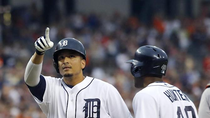 Detroit Tigers' Victor Martinez celebrates his grand slam with teammate Torii Hunter (48) in the first inning of a baseball game to take a 4-2 lead over the Boston Red Sox, Saturday, June 22, 2013, in Detroit. (AP Photo/Duane Burleson