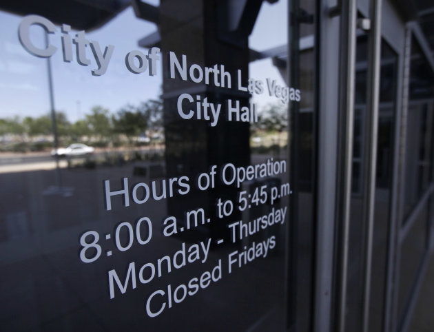 Office hours are posted on the front door of the North Las Vegas City Hall building, Thursday, June 21, 2012, in North Las Vegas, Nev. Despite its suburban trimmings, this blue-collar, family-oriented