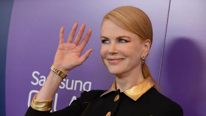 "FILE - In this Oct. 4, 2013 file photo, actress Nicole Kidman arrives at Variety's 5th Annual Power of Women event at the Beverly Wilshire Hotel, in Beverly Hills, Calif. The Weinstein Co. is postponing the March 2014 release of ""Grace of Monaco,"" starring Kidman. (Photo by Jordan Strauss/Invision/AP, File)"