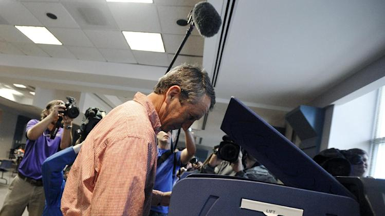 Former South Carolina Gov. Mark Sanford votes at a polling place in Charleston, S.C., Tuesday, May 7, 2013.  Sanford, a Republican, and Colbert Busch, a Democrat and sister of political satirist Stephen Colbert, are to face off for the 1st Congressional District seat, that was vacated when Tim Scott was appointed to the U.S. Senate. Green Party candidate Eugene Platt also is on the ballot.  (AP Photo/Rainier Ehrhardt)