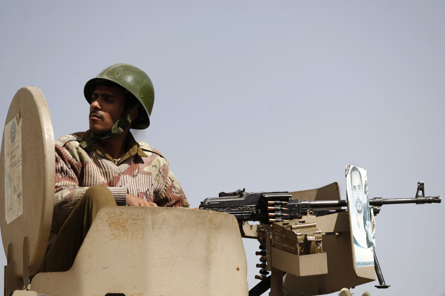 A Yemeni soldier sits atop a military vehicle securing a street during a rally by pro-democracy protestors in Sanaa, Yemen, Friday, Dec. 28, 2012.