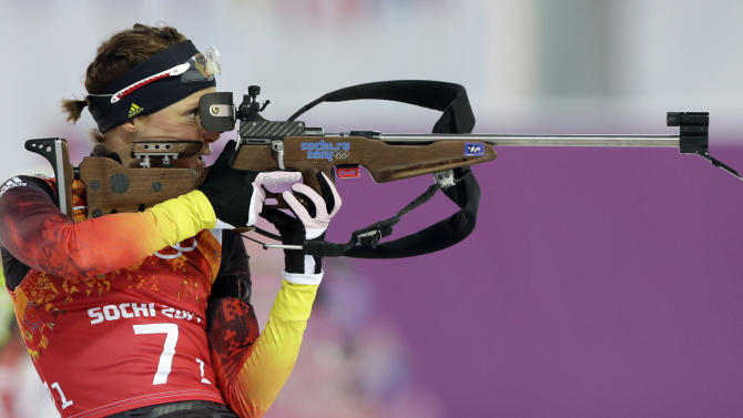 Germany's Evi Sachenbacher-Stehle shoots during the mixed biathlon relay at the 2014 Winter Olympics, Wednesday, Feb. 19, 2014, in Krasnaya Polyana, Russia. (AP Photo/Lee Jin-man)