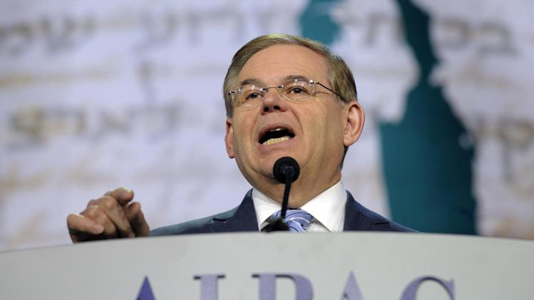 FILE - In this March 5, 2013 file photo, Senate Foreign Relations Committee Chairman Sen. Robert Menendez, D-N.J., addresses the American-Israeli Public Affairs Committee (AIPAC) 2013 Policy Conference at the Walter E. Washington Convention Center in Washington. Beyond the investigations, it's business as usual for Menendez. The newly minted Foreign Relations Committee chairman presides over hearings on North Korea and counterterrorism, travels to Afghanistan and Pakistan and meets privately with foreign ministers and ambassadors.  (AP Photo/Susan Walsh, File)