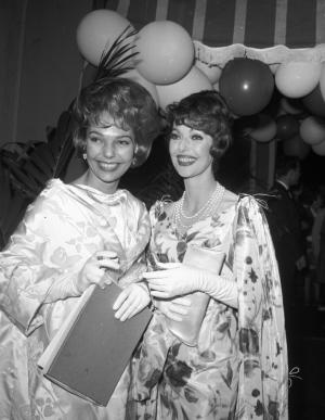 """FILE - In this May 16, 1961 file photo, actress Loretta Young, right, and her daughter Judy Lewis attend a party following the Emmy awards in Hollywood Calif. For decades, the identity of Judy Lewis' parents was one of the best-kept secrets in Hollywood. Not until Lewis acknowledged her story in the 1994 biography """"Uncommon Knowledge"""" did the general public knew the truth: Lewis was not the adopted daughter of Hollywood starlet Loretta Young, but had been conceived out of wedlock by Young and Clark Gable while the two filmed """"Call of the Wild"""" in the 1930s. Lewis died Friday in the Philadelphia suburb of Gladwyne, Pa. She was 76. (AP Photo/File)"""