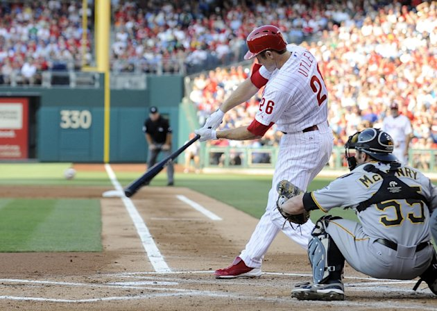Philadelphia Phillies' Chase Utley hits a home run in front of Pitsburgh Pirates catcher Michael McKenry in the first inning of a baseball game Wednesday, June 27, 2012, in Philadelphia. (AP Photo/Michael Perez)