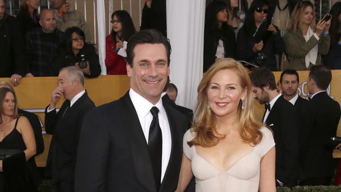 Jon Hamm and Jennifer Westfeldt arrive at the 19th Annual Screen Actors Guild Awards at the Shrine Auditorium in Los Angeles on Sunday Jan. 27, 2013. (Photo by Todd Williamson/Invision for The Hollywood Reporter/AP Images)
