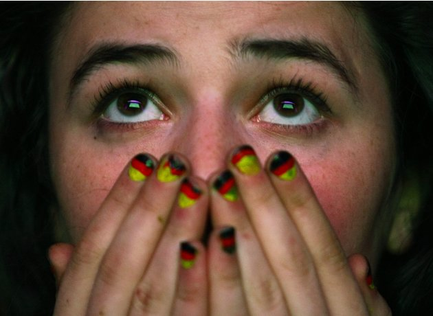 A Germany soccer fan reacts during the Euro 2012 semi-final soccer match between Germany and Italy at a public screening of the match in Warsaw