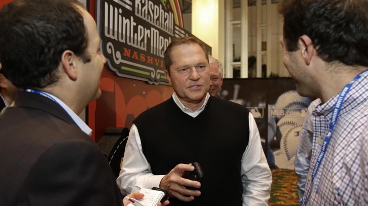 Sports agent Scott Boras, center, talks with reporters at the baseball winter meetings on Wednesday, Dec. 5, 2012, in Nashville, Tenn. (AP Photo/Mark Humphrey)