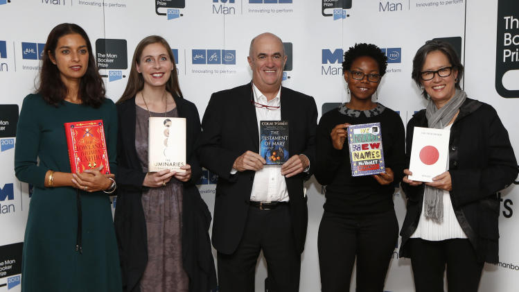 Shortlisted authors, from left, Jhumpa Lahiri, Eleanor Catton, Colm Toibin, NoViolet Bulawayo and Ruth Ozeki pose with their books during a photocall for the shortlisted authors of the 2013 Man Booker Prize for Fiction at the Queen Elizabeth Hall in London, Sunday, Oct. 13, 2013. The media presentation of short listed authors is a tradition ahead of the the winner of the 50,000 pounds (US$80,000) prize being announced on Tuesday, Oct. 16. (AP Photo/Sang Tan)