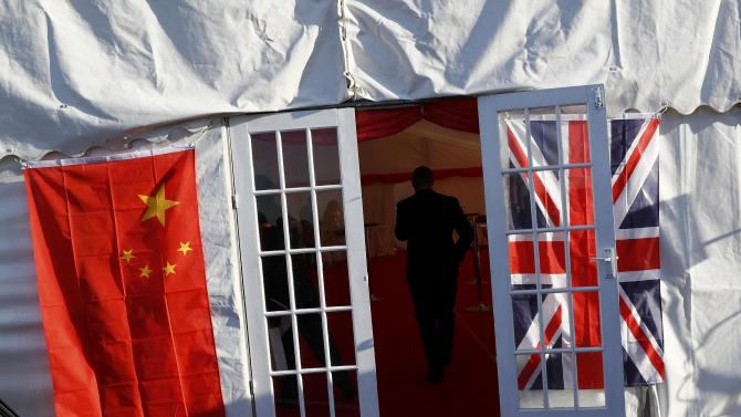 A man enters a tent during a welcoming ceremony to mark the inaugural trip for the first freight train to travel from China to Britain at Barking Intermodal Terminal near London near London