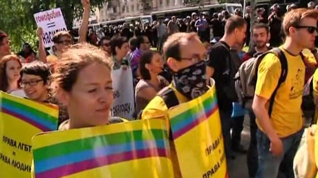 Police arrest dozens at gay rallies