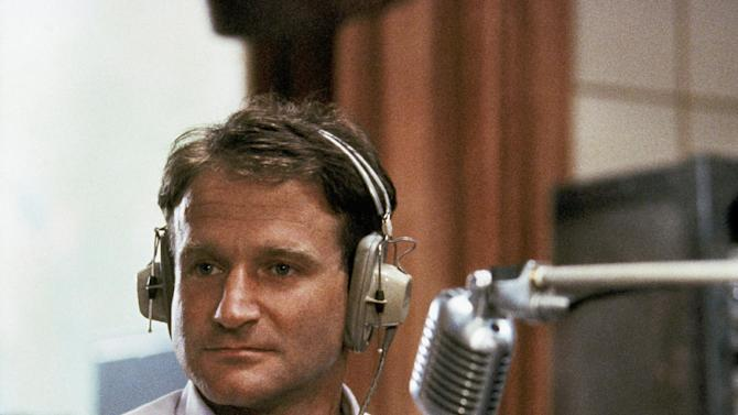 """FILE - This 1987 file photo released by Touchstone Pictures shows actor Robin Williams in character as disc-jockey Adrian Cronauer in director Barry Levinsons comedy drama, """"Good Morning Vietnam."""" Williams, whose free-form comedy and adept impressions dazzled audiences for decades, has died in an apparent suicide. He was 63. The Marin County Sheriff's Office said Williams was pronounced dead at his home in California on Monday, Aug. 11, 2014. The sheriff's office said a preliminary investigation showed the cause of death to be a suicide due to asphyxia. (AP Photo/Touchstone Pictures)"""