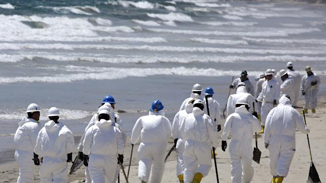 Crews clean up El Capitan State Beach after a massive oil spill on the Californian coast in Goleta