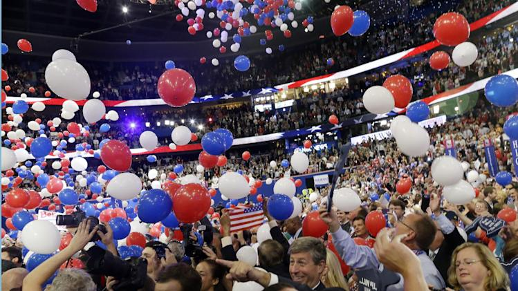 Balloons fall as Republican presidential nominee Mitt Romney and Republican vice presidential nominee, Rep. Paul Ryan's families take the stage at the Republican National Convention in Tampa, Fla., on Thursday, Aug. 30, 2012. (AP Photo/Charles Dharapak)