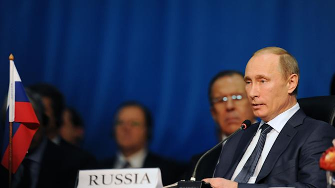 Russian President Vladimir Putin listens to speeches during the BRICS 2013 Summit in Durban, South Africa, Wednesday,  March 27, 2013. Heads of State of BRICS nations met in the South African city of Durban for the two-day summit. (AP Photo/Sabelo Mngoma)