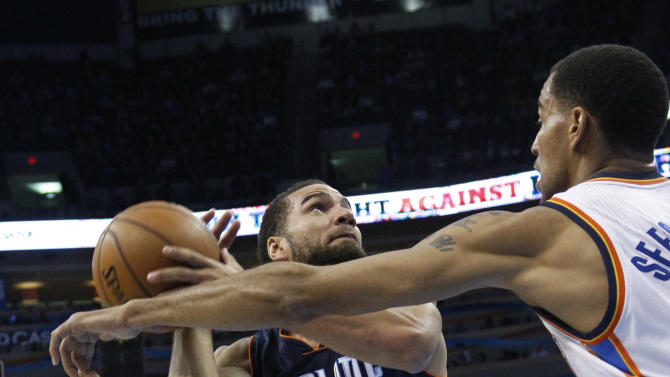 Charlotte Bobcats Jeff Taylor (44) looks for a shot as Oklahoma City Thunder guard Thabo Sefolosha, right, defends, in the first quarter of an NBA basketball game in Oklahoma City, Monday, Nov. 26, 2012. (AP Photo/Sue Ogrocki)