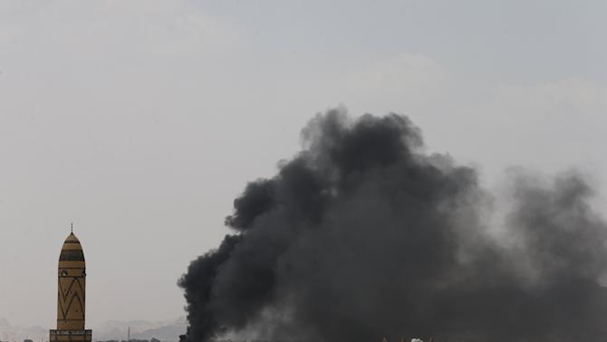 Smoke billows from the military academy during a Saudi-led air strike in Sanaa