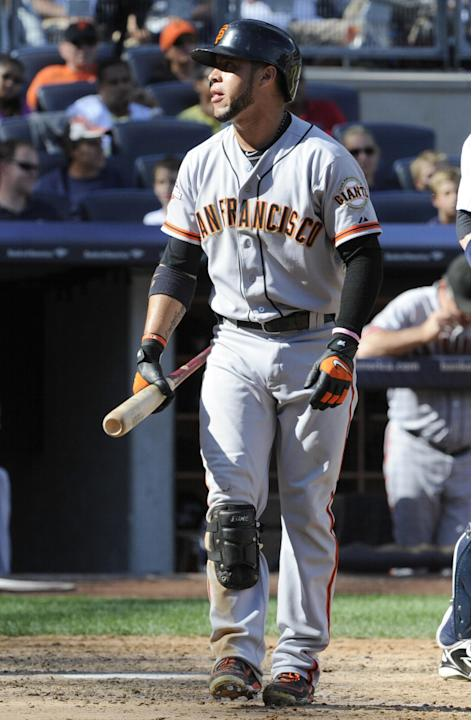 San Francisco Giants' Gregor Blanco reacts after striking out during the eighth inning of an inter-league baseball game against the New York Yankees Saturday, Sept. 21, 2013, at Yankee Stadium in New