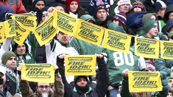 New York Jets fans wave towels requesting the dismissal of general manager John Idzik during their game in East Rutherford, New Jersey