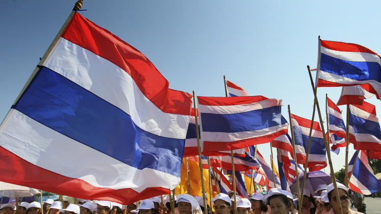 Workers demanding a wage increase carry Thai flags during a May Day rally in Bangkok on Tuesday, May 1, 2012. (AP Photo/Sakchai Lalit)