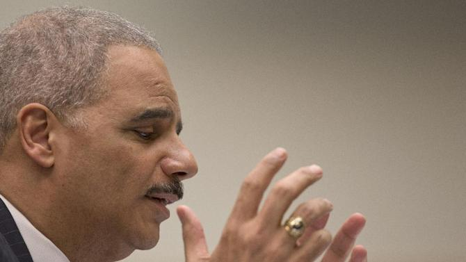 Attorney General Eric Holder gestures as he testifies on Capitol Hill in Washington, Wednesday, May 15, 2013, before the House Judiciary Committee oversight hearing on the Justice Department. Holder is expected to face aggressive questioning on topics ranging from the Justice Department's gathering of phone records at the Associated Press to the government's handling of intelligence before the Boston Marathon bombings. (AP Photo/Carolyn Kaster)