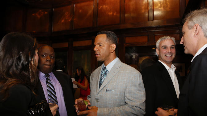 IMAGE DISTRIBUTED FOR GOLD STANDARD SPORTS - Special guest Andre Reed, center, attends the Steve Smith Samaritan's Feet VIP Party at the August restaurant on Wednesday, Jan. 30, 2013 in New Orleans, Louisiana. (Aaron M. Sprecher/AP Images for Gold Standard Sports/BRANDed)