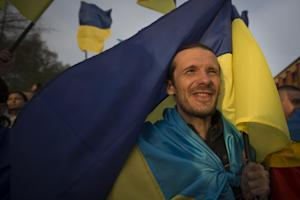 A man holds a Ukrainian national flag during a rally …