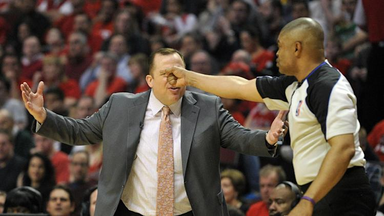 Chicago Bulls head coach Tom Thibodeau reacts as referee Tony Brothers (25) calls a foul  during the first half in Game 4 of their first-round NBA basketball playoff series against the Brooklyn Nets on Saturday, April 27, 2013, in Chicago. (AP Photo/Jim Prisching)