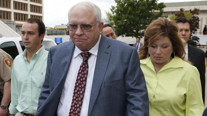 File - In this April 21, 2015 file photo, Robert Bates, second from right, leaves his arraignment in Tulsa, Okla. Bates, a 73-year-old Tulsa County reserve deputy, fatally shot a suspect who was pinned down by officers. Attorneys for the man killed have released a report that says Bates didn't receive special treatment for admittance into the advanced deputy program, but that he did receive special treatment once admitted. With Bates are his daughter, Leslie McCreary, right, and an unidentified grandson, left.  (AP Photo/Sue Ogrocki, File)