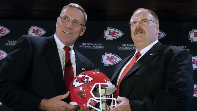 New Kansas City Chiefs general manager John Dorsey, left, poses with new head coach Andy Reid during an NFL football news conference announcing Dorsey's hiring Monday, Jan. 14, 2013, in Kansas City, Mo. (AP Photo/Charlie Riedel)