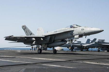 U.S. Navy handout shows F/A-18F Super Hornet attached to the Tomcatters of Strike Fighter Squadron 31 landing aboard the aircraft carrier USS George...