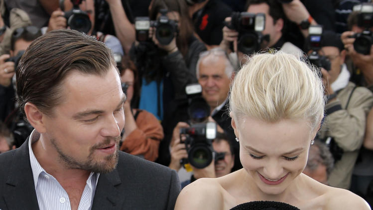 Actors Leonardo DiCaprio and Carey Mulligan pose for photographers during a photo call for the film The Great Gatsby at the 66th international film festival, in Cannes, southern France, Wednesday, May 15, 2013. (AP Photo/Francois Mori)