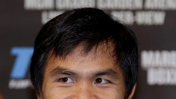 Manny Pacquiao plays to supporters during a news conference, Wednesday, Dec. 5, 2012, in Las Vegas. Pacquiao is scheduled to take on Juan Manuel Marquez in a welterweight boxing match on Saturday. (AP Photo/Julie Jacobson)