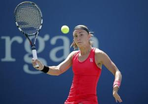 Aleksandra Krunic of Serbia hits a return to Petra Kvitova of the Czech Republic during their match at the 2014 U.S. Open tennis tournament in New York