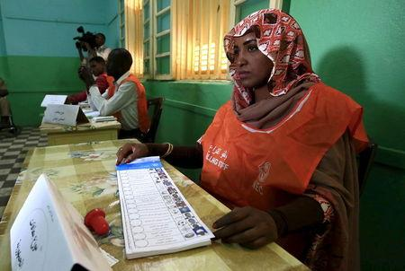 An election official seen with ballot papers during elections in the capital Khartoum