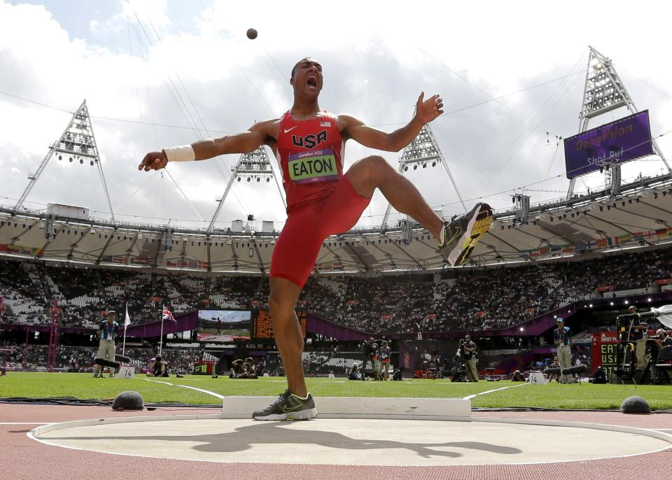 United States' Ashton Eaton reacts after his throw in the shot put in the decathlon during the athletics in the Olympic Stadium at the 2012 Summer Olympics, London, Wednesday, Aug. 8, 2012. (AP Photo/David J. Phillip)