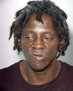 File - This Oct. 17, 2012 file image released by the Las Vegas Police Department shows rapper Flavor Flav, also known as William Jonathan Drayton, Jr., in a police booking photo. Entertainer Flavor Flav is expected to plead not guilty in Nevada state court to felony charges alleging he chased and threatened his longtime girlfriend's 17-year-old son with a butcher knife during a family argument last October. (AP Photo/Las Vegas Police Department, file)