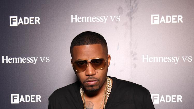 IMAGE DISTRIBUTED FOR HENNESSY - Spokesperson Nas arrives at Hennessy V.S and FADER Event at Pulse Art Festival on Thursday, Dec. 5, 2013 in Miami, FL. (Photo by Omar Vega/Invision for Hennessy/AP Images)