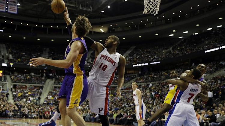 Detroit Pistons center Greg Monroe (10) fouls Los Angeles Lakers forward Pau Gasol, left, of Spain, as Lakers forward Metta World Peace fouls Pistons guard Brandon Knight (7) during the first quarter of an NBA basketball game at the Palace of Auburn Hills, Mich., Sunday, Feb. 3, 2013. (AP Photo/Carlos Osorio)